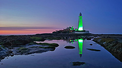 © Licensed to London News Pictures. 23/04/2020. Whitley Bay, UK. St Mary's lighthouse in Whitley Bay, North Tyneside illuminated green in recognition and support of NHS workers and carers fighting the coronavirus pandemic. Photo credit: Colin Scarr/LNP