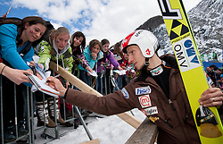 Robert Kranjec of Slovenia with children as supporters during the Flying Hill Individual Qualification at 1st day of FIS Ski Jumping World Cup Finals Planica 2013, on March 21, 2012, in Planica, Slovenia. (Photo by Vid Ponikvar / Sportida.com)
