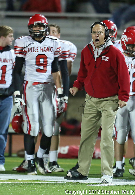 Iowa City High head coach Dan Sabers yells to his players on the field during during the game between the Iowa City High Little Hawks and the Linn-Mar Lions at Linn-Mar Stadium in Marion on Friday October 12, 2012.
