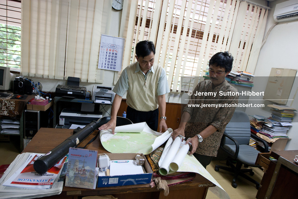 Budhi Gunawan (in batik shirt) of Ecosystems Studies department, and Parikesit (short sleeved shirt) - a landscape ecologist, in the Institute of Ecology Research, at Padjadjaran University, in Bandung, Western Java province, Indonesia, Tuesday 26th October 2010.