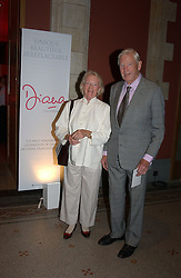 Former newsreader SANDY GALL and his wife ELEANOR GALL at a party to celebrate the UK launch of Diana:The Portrait, the authorised book about the late Princess Of Wales's life and work, held at the National Portrait Gallery, London on 1st September 2004.  The book was commissioned by The Diana, Princess of Wales Memorial Fund and writen by Ros Coward.