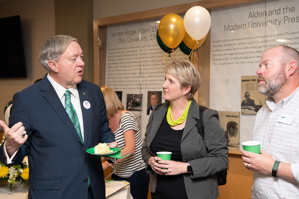 President Nellis speaks with Candace and Chad  Boeninger at the 50th Anniversary of Alden Library. Photo by Ben Siegel