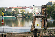 Czech Republic, Prague, Vltava River, wooden chair modern art, the National Theatre in the background
