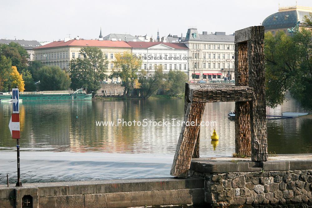 Czech Republic, Prague, Vltava River, wooden chair modern art, the National Theatre in the background