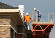 Jeremy Blumley (from left) and Adam Kafar both of Dubuque work on the outside of the Stonefield Commercial Center in Marion on Friday morning, September 2, 2011. Blumley and Kafar work for Cummer Masonry.