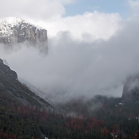 El Capitan and Bridal Veil waterfall in snow and fog. Yosemite National Park, California