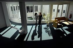 Office workers having a conversation. (Photo © Jock Fistick)