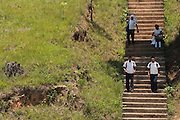 Children walk down concrete stairs as they home from school in El Carbon, Honduras on Thursday April 25, 2013.