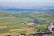 Nederland, Utrecht, Gemeente Eemnes, 06-09-2010; polders tussen Eemnes en Spakenburg gezien naar Flevoland. Een van de laatste open polderlandschappen in de Randstad. Het riviertje de Eem mondt uit in het Eemmeer.  De polders zijn: Zuidpolder te Veld, Noordpolder te Veld, Maatpolder Bikkerspolder. De weg is  .Rijksweg A1 ter hoogte van Baarn..Polders between Eemnes and Spakenburg seen to Flevoland. One of the last open polder landscapes in the Randstad. The river Eem flows into the Eemmeer. The road is A1 highway..luchtfoto (toeslag), aerial photo (additional fee required).foto/photo Siebe Swart