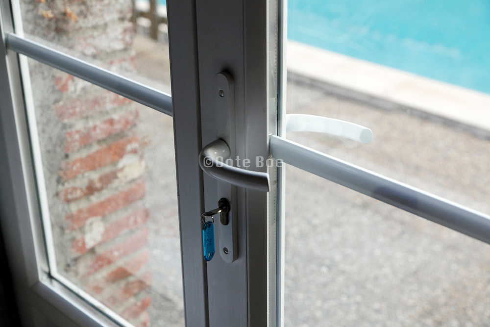 key and door with access to the swimming pool