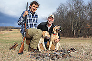 Chukar Hunting at Marsh Lake preserve in Victoria, MN Cecil Bell (right) with his son Ethan and Yellow Labs Wally and Bric