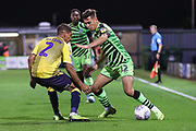 Forest Green Rovers Taylor Allen(12) holds off Coventry City's Tennai Watson(2) during the Leasing.com EFL Trophy match between Forest Green Rovers and Coventry City at the New Lawn, Forest Green, United Kingdom on 8 October 2019.