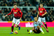 Victor Lindelof (#2) of Manchester United successfully challenges Jose Salomon Rondon (#9) of Newcastle United to win possession of the ball during the Premier League match between Newcastle United and Manchester United at St. James's Park, Newcastle, England on 2 January 2019.