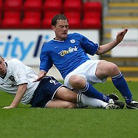 St Johnstone v Ross County....17.04.04<br />Jim Hamilton tackles Ian Maxwell<br /><br />Picture by Graeme Hart.<br />Copyright Perthshire Picture Agency<br />Tel: 01738 623350  Mobile: 07990 594431