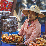 Lady selling shrimp patties on the banks of the Ayerawady River