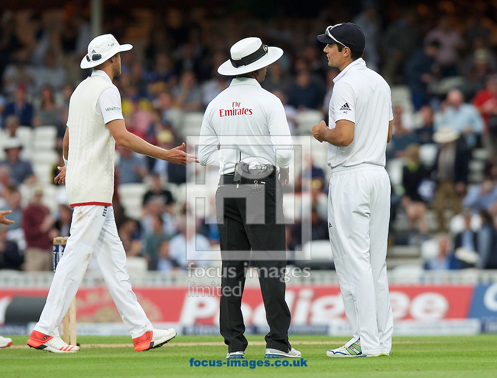 Captain Alastair Cook of England asks Umpire Kumar Dharmasena why they have stopped play for the light as Stuart Broad walks off frustrated during the 5th Investec Ashes Test Match match at the Kia Oval, London<br /> Picture by Alan Stanford/Focus Images Ltd +44 7915 056117<br /> 20/08/2015