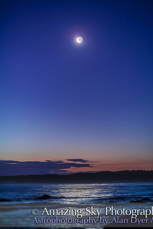 The &ldquo;upside-down&rdquo; waxing crescent Moon in the evening sky from Victoria, Australia, at Cape Conran, West Cape area, on the Gippsland Coast, at latitude 37&deg; South. Earthshine lights the dark side of the Moon. This was March 31, 2017. The Moon lights a glitter path on the water. <br /> <br /> This is a single 1.3-second exposure at f/2 with the 85mm Rokinon lens, and Canon 5D MkII at ISO 400.