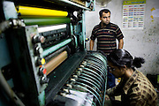 Mr Ali, the owener of a printing company waits for power to be restored at a printing workshop in the 'Old City' sector of Lahore. ..Parts of Pakistan are reportedly suffering 12-20-hours of electricity load shedding (power outages) per day. One for the reasons given by the government is that of illegal tampering of electrical meters and bribery of meter readers...Many industries are suffering as a result of not being ale to use production machinery during load shedding and are unable meet deadlines for manufacture and delivery of goods.