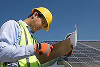 Maintenance worker with photovoltaic array in Los Angeles California