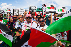 London, August 9th 2014. Palestinians and their supporters listen to speeches at a rally in Hyde Park following a mach from the BBC Headquarters in London,via the US embassy, by up to 150,000 people.