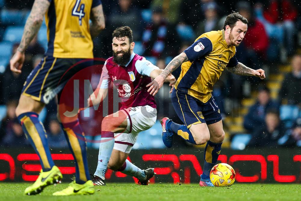 Lee Tomlin of Bristol City is challenged by Mile Jedinak of Aston Villa - Rogan Thomson/JMP - 28/02/2017 - FOOTBALL - Villa Park - Birmingham, England - Aston Villa v Bristol City - Sky Bet EFL Championship.