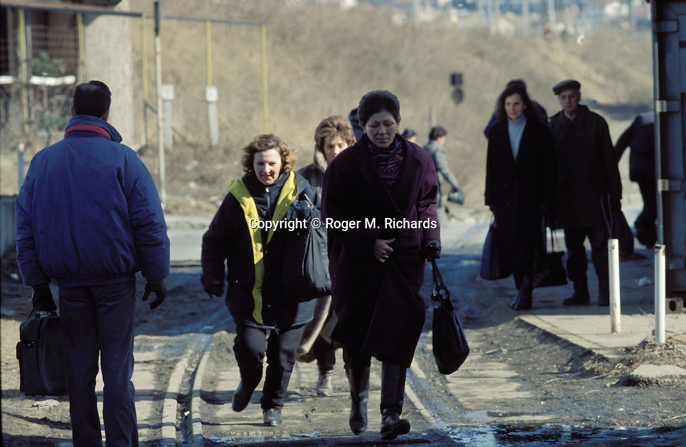 Pedestrians run through an exposed intersection where a Serb sniper shoots during the Bosnian Serb siege of Sarajevo, Bosnia and Herzegovina, December 1992. Almost 2,000 children, and over 10,000 people in total were killed in Sarajevo during the 3-1/2 year siege. (Photo by Roger Richards)