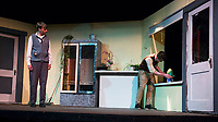 """Chris Weimann as Mushnik watches as Riley Alward as Seymour tends to """"Audrey II"""" in an attempt to save the failing Mushniks Flower Shop during dress rehearsal for Little Shop of Horrors with Gilford High School Tuesday afternoon.  (Karen Bobotas/for the Laconia Daily Sun)"""