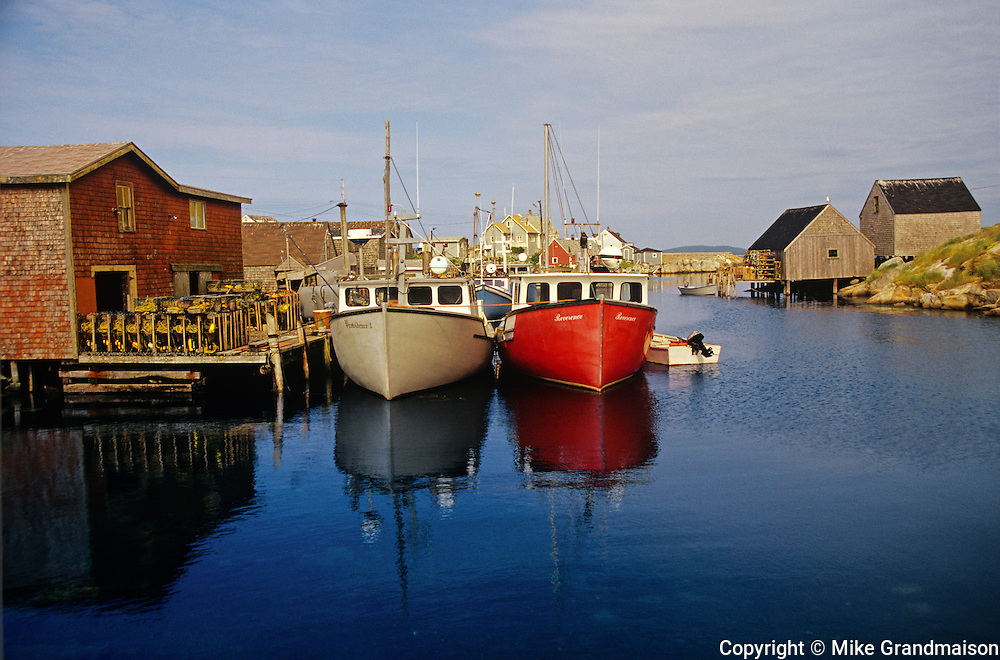 boats in harbour  and fishing village  major tourist attraction<br /> Peggy's Cove<br /> Nova Scotia<br /> Canada