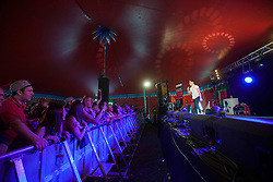 Russell Kane on the Sun Comedy tent, Sunday, T in the Park 2014.<br /> © Michael Schofield.
