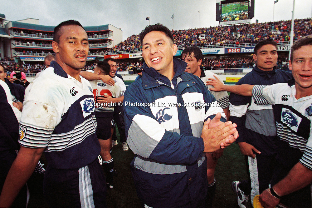 Jonah Lomu and Brian Errol celebrate after their win in the final.<br /> Super 12 Rugby final between the Auckland Blues and Natal Sharks at Eden Park, Auckland, New Zealand on 25 May 1996.<br /> The Blues won the final 45-21.<br /> Copyright photo: www.photosport.nz