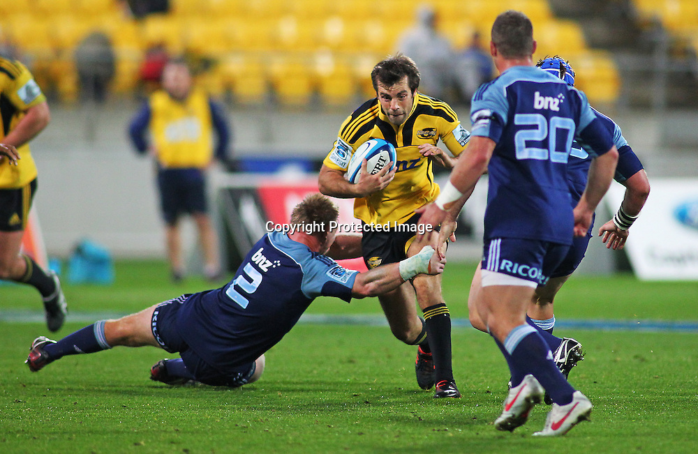 Conrad Smith looks to make a break during their Super Rugby match, Hurricanes v Blues, Westpac stadium, Wellington, New Zealand. Friday 4 May 2012.  PHOTO: Grant Down / photosport.co.nz