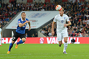 England striker Harry Kane breaks away watched by Estonia defender Enar Jaager during the Group E UEFA European 2016 Qualifier match between England and Estonia at Wembley Stadium, London, England on 9 October 2015. Photo by Alan Franklin.