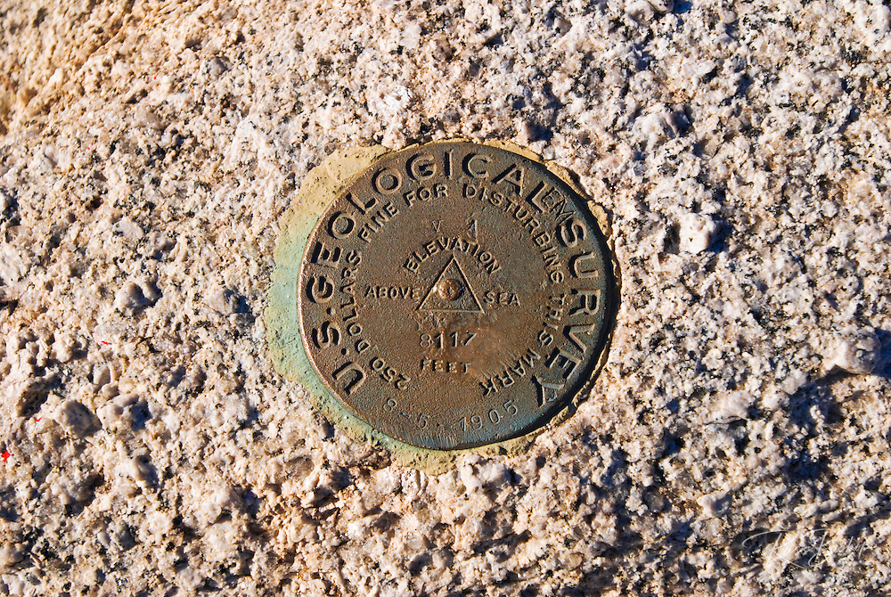 USGS surveyl marker on the summit of Sentinel Dome, Yosemite National Park, California