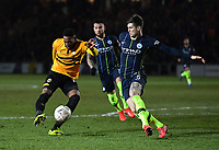 Football - 2018 / 2019 Emirates FA Cup - Fifth Round: Newport County vs. Manchester City<br /> <br /> Newport County's Jamille Matt gets in a shot despite the efforts of Manchester City's John Stones, at Rodney Parade.<br /> <br /> COLORSPORT/ASHLEY WESTERN