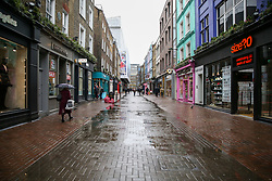 © Licensed to London News Pictures. 04/03/2020. London, UK. Empty Carnaby Street just before 3pm as tourists and locals are staying away due to Coronavirus outbreak. Fifty one people have tested positive of Coronavirus (Covid-19) in the UK. Photo credit: Dinendra Haria/LNP