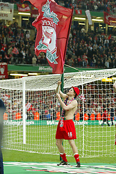 CARDIFF, WALES - Sunday, March 2, 2003: Liverpool's John Arne Riise waves a huge flag as he celebrates victory over Manchester United during the Football League Cup Final at the Millennium Stadium. (Pic by David Rawcliffe/Propaganda)