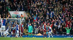 BLACKBURN, ENGLAND - Sunday, November 21, 2010: Aston Villa's goalkeeper Brad Friedel looks dejected as Blackburn Rovers' Morten Gamst Pedersen celebrates scoring the second goal during the Premiership match at Ewood Park. (Photo by David Rawcliffe/Propaganda)