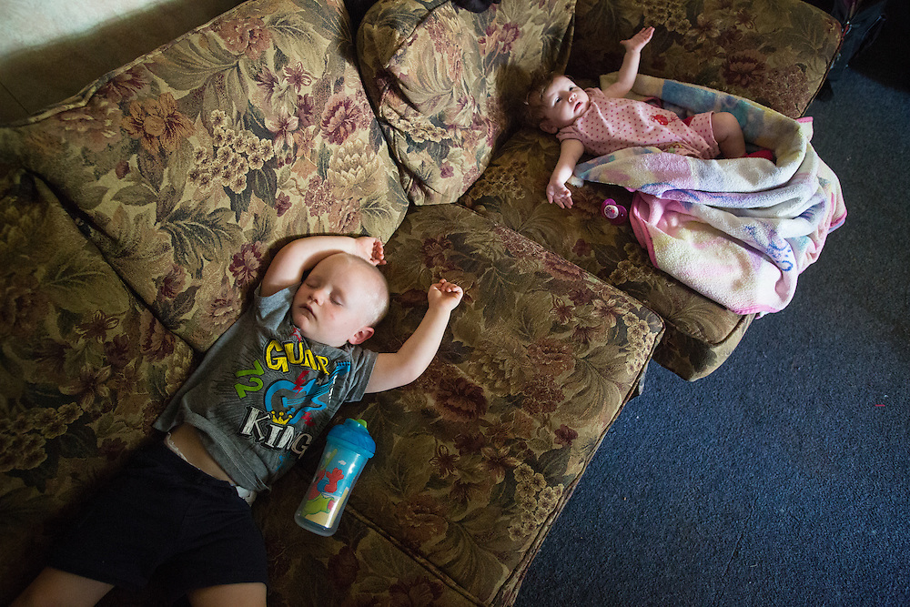 Makenly and Ryker sleep away the afternoon on the Hilts' living-room couch. As much as possible, Delores avoids hiring a babysitter, in part because they can't afford it but also because her experience of separation from her children has made her a more protective mother.