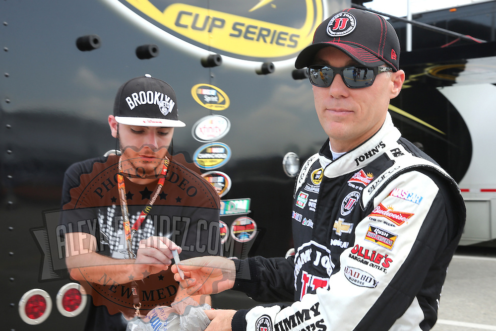 Sprint Cup Series driver Kevin Harvick (4) signs autographs during the 57th Annual NASCAR Coke Zero 400 race first practice session at Daytona International Speedway on Friday, July 3, 2015 in Daytona Beach, Florida.  (AP Photo/Alex Menendez)
