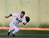 Kernels right fielder Matt Long (2) makes a diving catch during their game at Perfect Game Field at Veterans Memorial Stadium in Cedar Rapids on Wednesday, June 9, 2010. The Kernels defeated the Whitecaps 5-2.