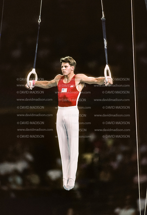 SEATTLE - JULY 1990:  Chris Waller of the United States performs an Iron Cross on the still rings during the gymnastics competition of the 1990 Goodwill Games held from July 20 - August 5, 1990.  The gymnastics venue was the Tacoma Dome in Tacoma, Washington.  (Photo by David Madison/Getty Images)