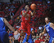 "Ole Miss guard Chris Warren (12)  shoots at the C.M. ""Tad"" Smith Coliseum in Oxford, Miss. on Tuesday, February 1, 2011. Ole Miss won 71-69."