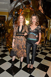 Left to right, ELLIE BAMBER and SAI BENNETT at a party to celebrate theunveiling of the Claridge's Christmas Tree designed by Christopher Bailey for Burberryheld at Claridge's, Brook Street, London on 18th November 2015.