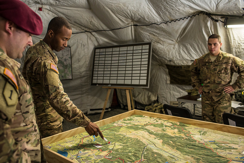 YAVORIV, UKRAINE - APRIL 30, 2015: Members of the U.S. Army's 173rd Airborne Brigade show the location of training exercises for Ukrainian soldiers on a topographical map as part of Operation Fearless Guardian at the Yavoriv training center near Yavoriv, Ukraine. Around 300 American soldiers are training an equivalent number of Ukrainians during each of three eight-week programs to improve their ability to combat Russian-backed rebels in the country's east. CREDIT: Brendan Hoffman for The New York Times