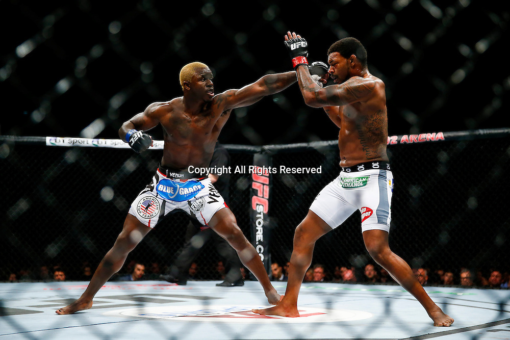 08.03.2014 London, England. Michael Johnson (white shorts) fights and beats Melvin Guillard (white and red logo shorts) in a 3 round Lightweight bout on the Main Card at UFC Fight Night London from the O2 Arena.