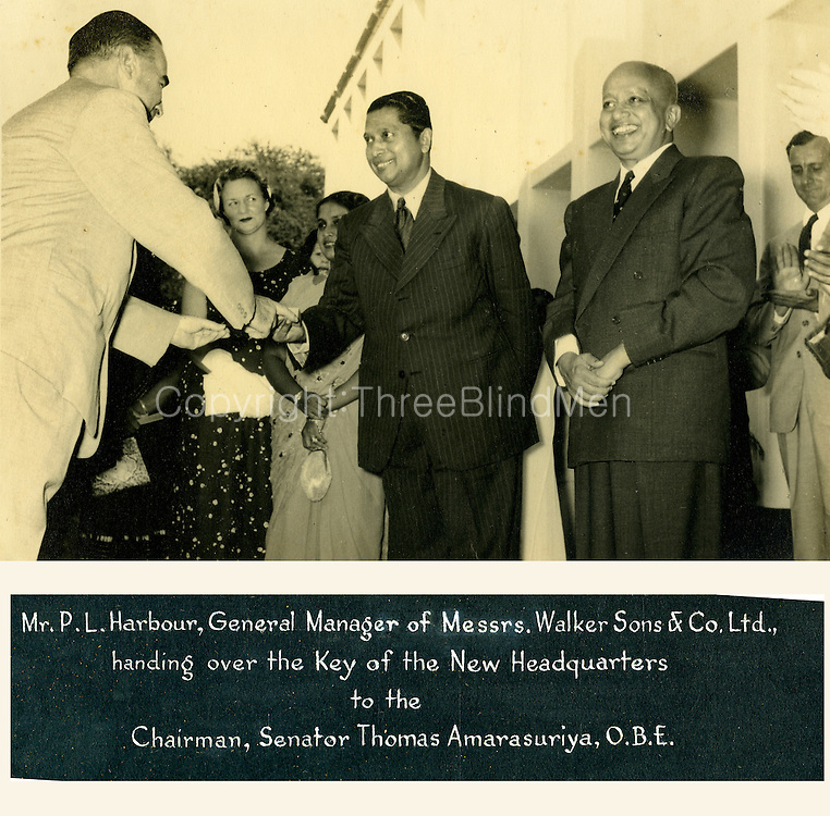 Mr. P. L. Harbour, General Manager of Messrs. Walkers Sons &amp; Co. Ltd., handing over the key to the new headquarters of the Plantation Association to the Chairman, Senator Thomas Amarasuriya O.B.E. On the right hand side of the picture is Sir Ernest Oliver Goonetilleke &ndash; Governor General. 29th March 1957<br /> <br /> from Planters Association Album.<br /> Thomas Amarasuriya, OBE (17 June 1907 &ndash; 5 May 1979) was a Ceylonese planter and politician. He was a member of the State Council of Ceylon and President of the Senate of Ceylon.[1] He was the first Ceylonese Chairman of the Planters Association and a brother of H. W. Amarasuriya.