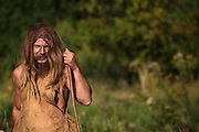 Scene of a hunter holding a spear in prehistoric times. Image taken from the filming of 'Paris la ville a remonter le temps' written by Carlo de Boutiny and Alain Zenou, directed by Xavier Lefebvre, a Gedeon Programmes production. Picture by Manuel Cohen
