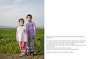Greece, Idomeni<br /> <br /> Ruhev Ali, age 6, and her sister Natelin Ali, age 9, from Arfin, North Syria March 2016 The father, told me they are kurdish, left Arfin 4 years before. They stayed in Turkey for 3 years, in big camps, than in flats mostly in Izmir. He didn&acute;t get payed for his work. Finally they made it to Greece. Since the borders are closed ,they moved to the Nea Kavala Camp, run by the Greek Army.The family still hopes to get to central Europe. Both girls like to go to school and they miss their friends a lot.Outside the Camp Nea Kavala, Polycastro, Idomeni, Greece<br /> <br /> Inside the Nea Kavala refugee camp which is run by the Greek army. 3.515 refugees, mainly families are currently living in the official Greek refugee camp with 600 tents in Nea Kavala. The Greek military opened and built this camp 1 month ago. The conditions in all the camps in Greece are not for a longterm stay so its meager. The camps are made for simple short stay. The tents are not heated. Facilities are very basic.<br /> <br /> The FYROM authorities, closed the border from Greece completely. The situation close to the border gets more and more difficult. There is not enough food and supplies to help about 14.000 refugees in March 2016<br /> <br /> keine Veroeffentlichung unter 50 Euro*** Bitte auf moegliche weitere Vermerke achten***Maximale Online-Nutzungsdauer: 12 Monate !!
