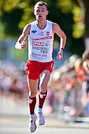 Marcin Chabowski from Poland competes in men's marathon during the Sixth Day of the European Athletics Championships Zurich 2014 at Letzigrund Stadium in Zurich, Switzerland.<br /> <br /> Switzerland, Zurich, August 17, 2014<br /> <br /> Picture also available in RAW (NEF) or TIFF format on special request.<br /> <br /> For editorial use only. Any commercial or promotional use requires permission.<br /> <br /> Photo by © Adam Nurkiewicz / Mediasport