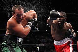 June 16, 2012; Newark, NJ, USA; Bryant Jennings (Red/White trunks) and Steve Collins (Black/Green trunks) trade punches during their 10 round USBA Heavyweight title bout.